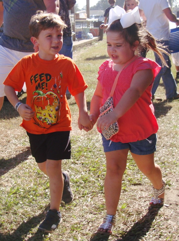 A Young Couple Hold Hands At 2016 French Food Fest In Larose Louisiana